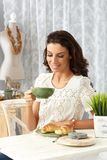 Young woman having breakfast at home Royalty Free Stock Images