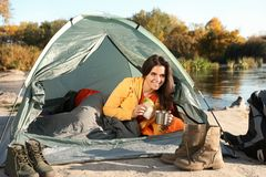 Young Woman Having Breakfast In Sleeping Bag Royalty Free Stock Photography