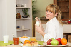 Young woman having breakfast Royalty Free Stock Photography