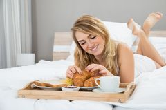 Young woman having breakfast Stock Image