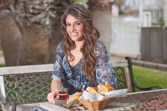 Young woman having breakfast outside Royalty Free Stock Photos