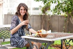 Young woman having breakfast outside Royalty Free Stock Photo
