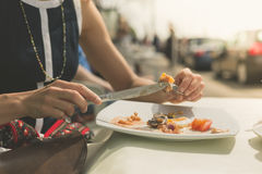 Young woman having breakfast outside Stock Photos
