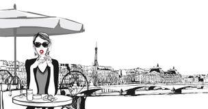 Young woman having breakfast in Paris Stock Photo