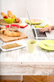 Young woman having breakfast while using a laptop computer Royalty Free Stock Photos