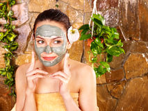 Young woman  having clay body mask. Royalty Free Stock Photo