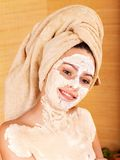 Young woman  having clay body mask. Stock Image