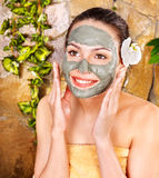 Young woman  having clay body mask. Stock Photography