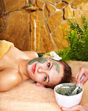 Young woman  having clay body mask. Stock Images