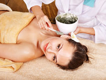 Young woman  having clay body mask. Royalty Free Stock Images