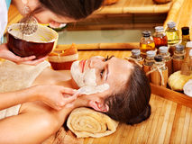 Young woman  having clay facial mask. Royalty Free Stock Photos