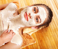 Young woman  having clay facial mask. Stock Image