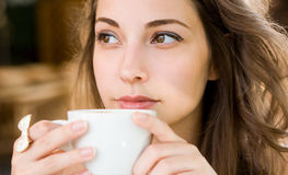 Young woman having coffee. Royalty Free Stock Image