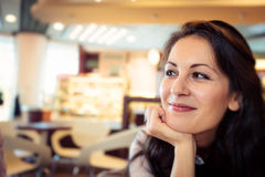 Young Woman Having Coffee In A Cafe Royalty Free Stock Photo
