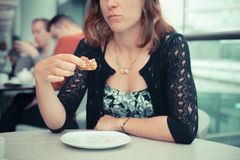 Young woman having coffee and cake Stock Photo