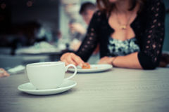 Young woman having coffee and cake Royalty Free Stock Images