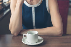 Young woman having coffee in diner Stock Images