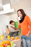 Young woman having coffee in the kitchen Royalty Free Stock Photography