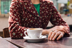Young woman having coffee outside Royalty Free Stock Photography