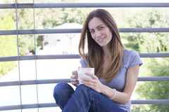Young woman having a coffee on terrace Royalty Free Stock Photo
