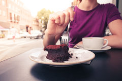 Young woman having coffeee and cake Stock Images