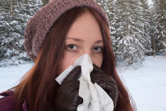 Young woman having a cold and flu virus outdoors Royalty Free Stock Photo