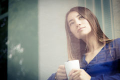 Young Woman Having A Cup Of Coffee Royalty Free Stock Photo