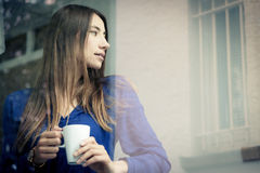 Young Woman Having A Cup Of Coffee Stock Photos