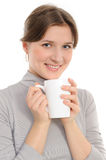 Young woman  having cup of tea Stock Photo