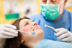 Young woman having a dental treatment Stock Image