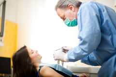 Young woman having a dental treatment Royalty Free Stock Images
