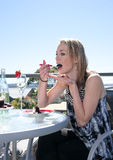 Young woman having dessert in cafe Royalty Free Stock Images