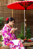 Young woman having dessert in tea house Stock Images