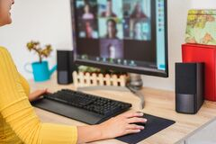Young woman having a discussion meeting in video call with her team - Girl having chatting with friends on computer web app -