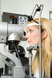 Young woman having eye test Stock Image