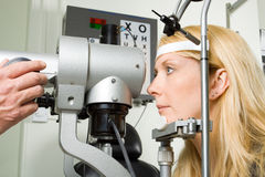 Young woman having eye test Stock Image