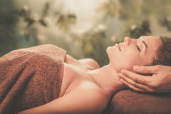 Young woman having face massage in a spa salon.  Royalty Free Stock Photos