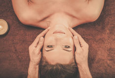 Young woman having face massage in a spa salon Royalty Free Stock Photo