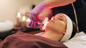 Young woman having face microdermabrasion at spa stock footage