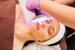 Young woman having face microdermabrasion at spa Stock Image