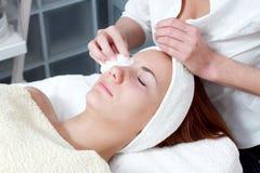 Woman having facial beauty treatment royalty free stock photos