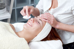 Woman having facial beauty treatment Royalty Free Stock Images