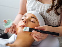 Young woman having a facial in the salon Stock Photography