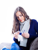 Young woman having flu. Against white background Stock Photo