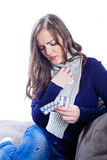 Young woman having flu. Against white background Stock Photos