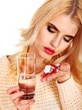 Young woman having flu takes pills. Royalty Free Stock Image