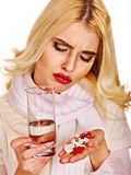 Young woman having flu takes pills. Royalty Free Stock Images