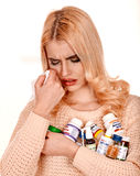 Young woman having flu takes pills. Young woman having toothache takes pills. Isolated Royalty Free Stock Photos