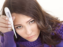 Young woman having  flue  taking thermometer. Stock Photos