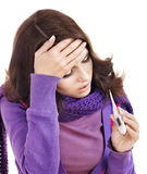Young woman having  flue  taking thermometer. Royalty Free Stock Photos